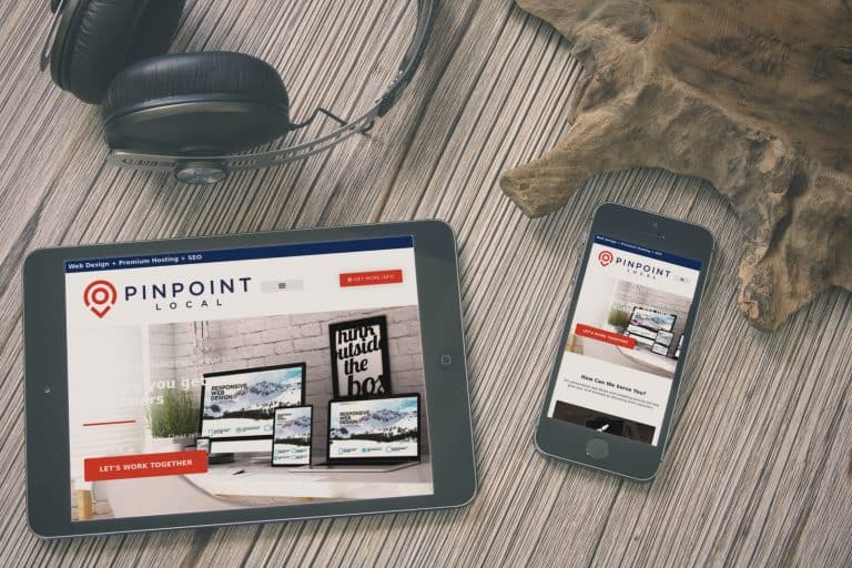 Ipad and iphone on a table displaying a responsive website